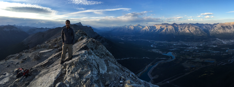 Ry at the summit with Canmore below