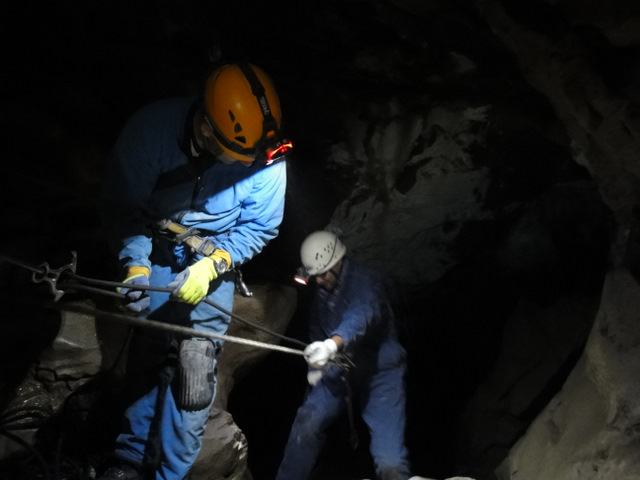 Rappelling 18 metres into the cave