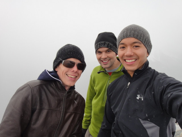At the summit. The snow was rolling in…
