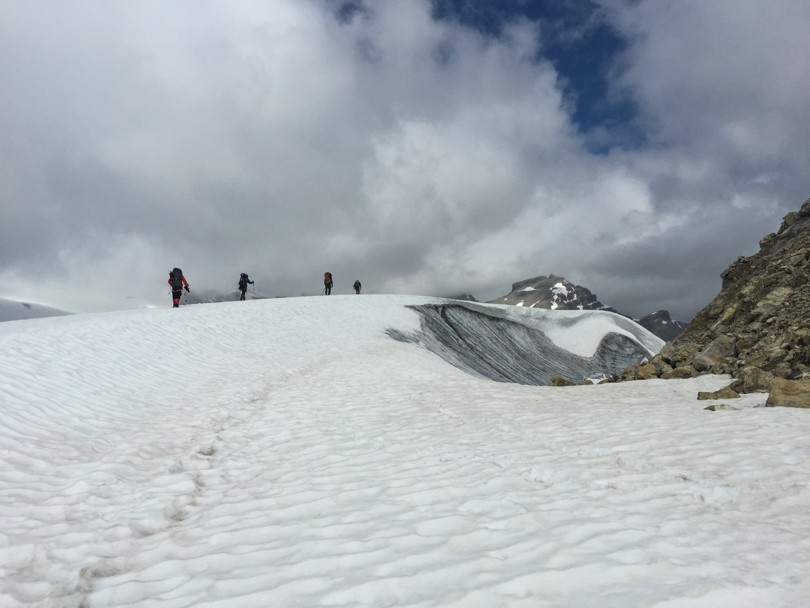 Crossing the glacier. This would be a great location for crevasse rescue practice.